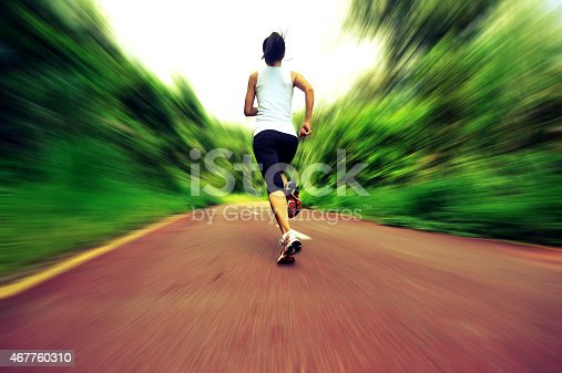 494003079istockphoto Runner athlete running on forest trail. 467760310