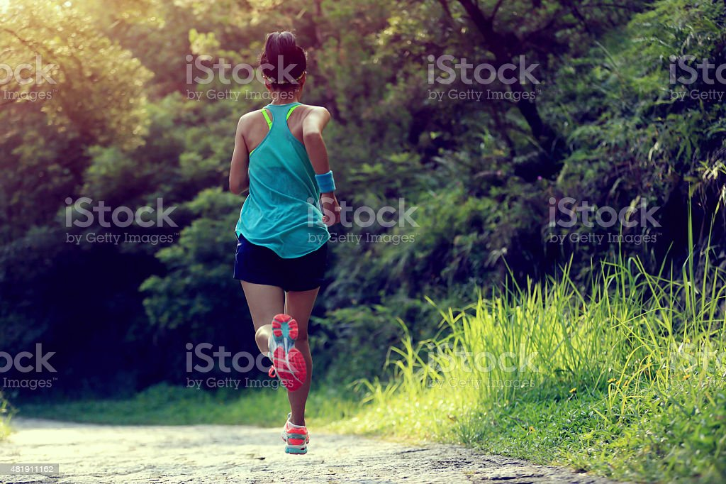 Runner athlete running on forest trail. royalty-free stock photo