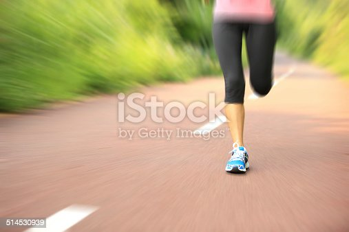 494003079istockphoto Runner athlete running on forest trail. 514530939