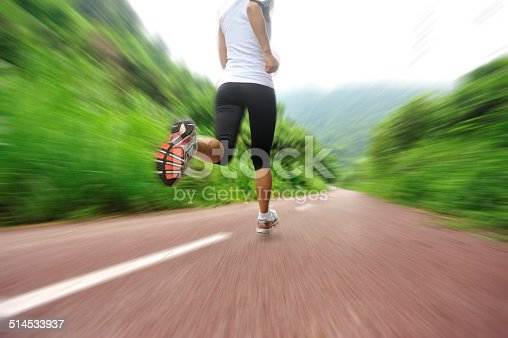 494003079istockphoto Runner athlete running on forest trail. 514533937