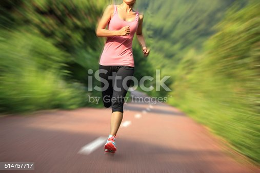 494003079istockphoto Runner athlete running on forest trail. 514757717