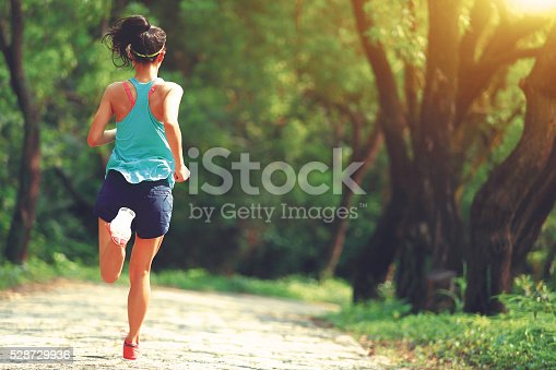 istock Runner athlete running on forest trail. 528729936