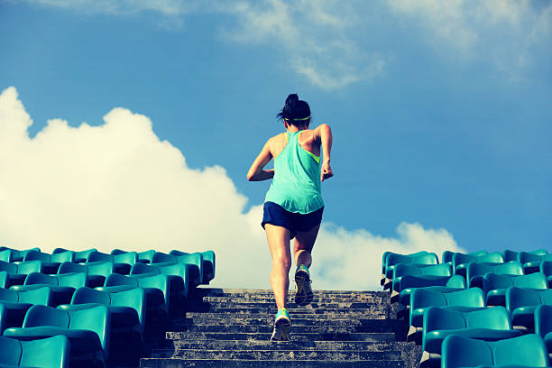 runner athlete running on stairs. - dedication stock photos and pictures