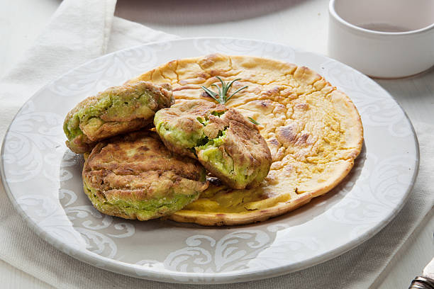 Runner beans fritters and chickpeas farinata A plate with runner beans fritters over italian style farinata, made with chickpeas flour, topped with rosemary farinata stock pictures, royalty-free photos & images