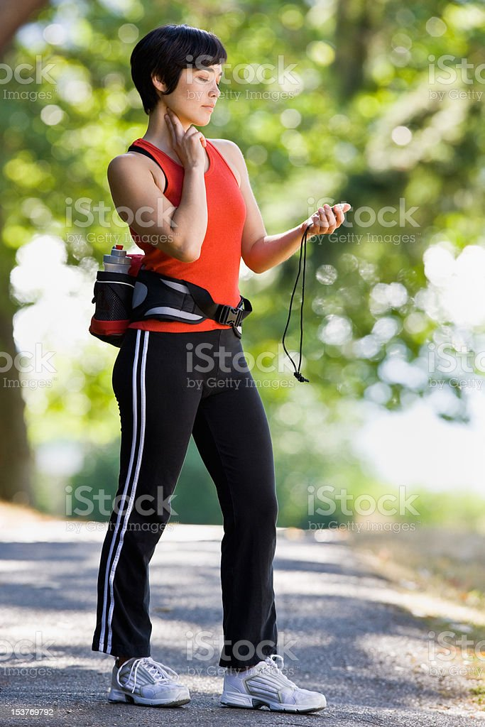 Runner checking pulse after exercising royalty-free stock photo