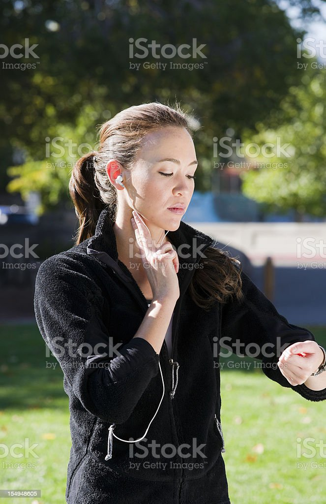 Runner Checking Pulse royalty-free stock photo