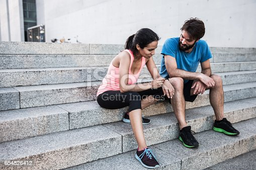 istock runner checking smartwatch 654826412