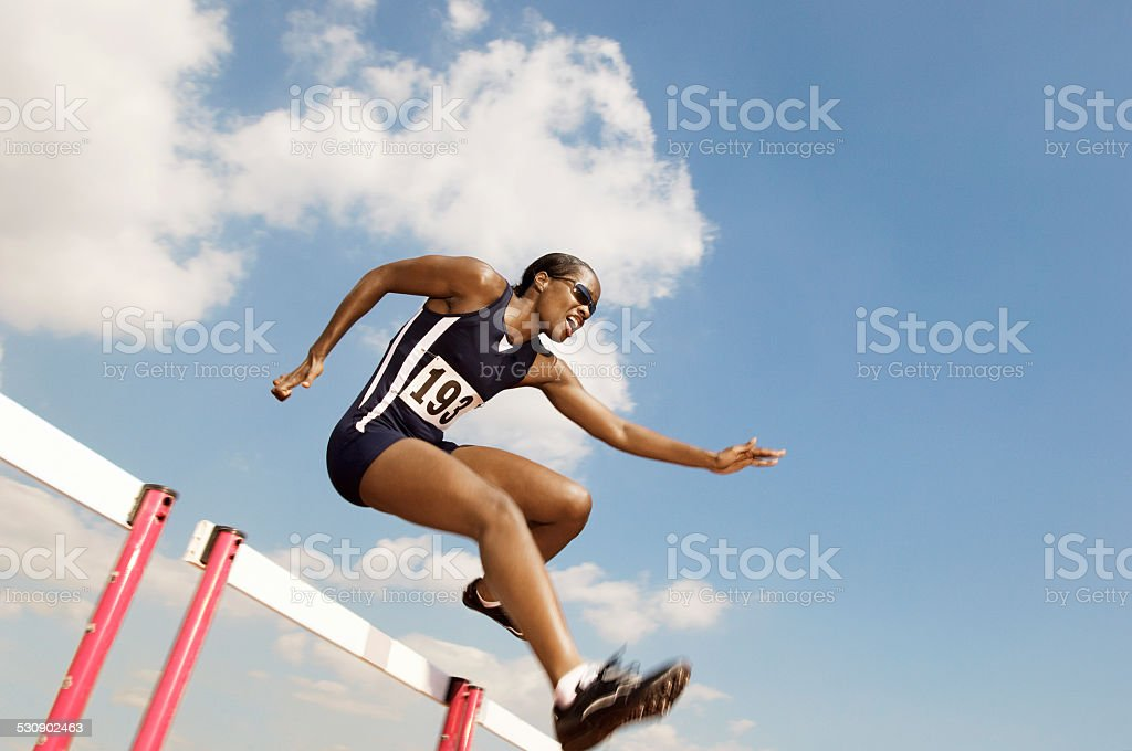 Runner Clearing Hurdle stock photo