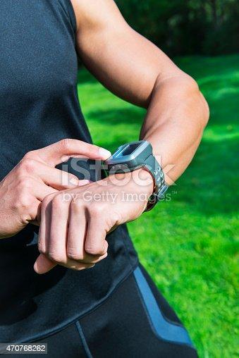 Runner man cheating pulse on smart watch