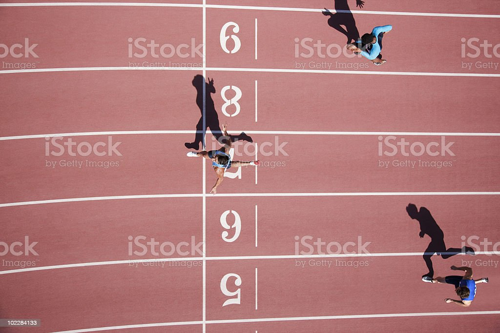 Runner crossing finishing line on track royalty-free stock photo