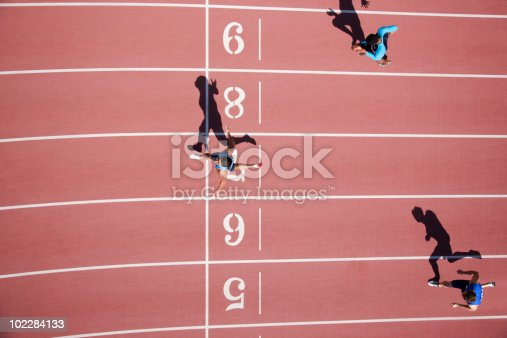 istock Runner crossing finishing line on track 102284133