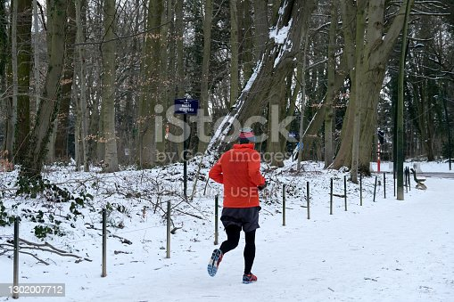istock A runner exercising  along a snow-covered park in Brussels, on February 10, 2021, following heavy snow fall over Belgium. 1302007712