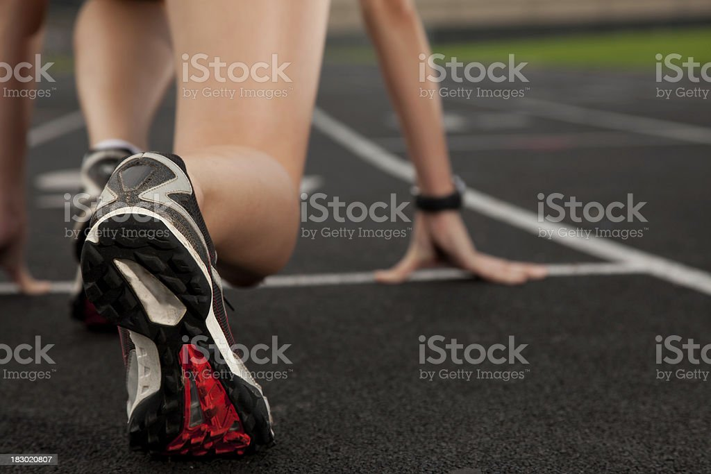 Runner Feet Closeup at the Start of a Track Race stock photo