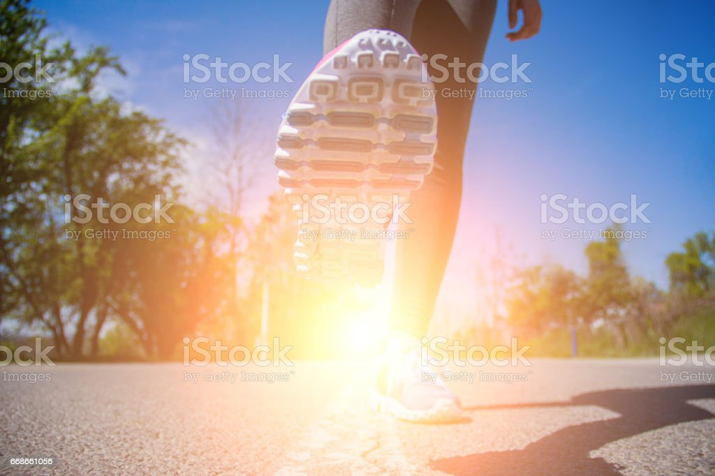 Runner feet sunrise stock photo