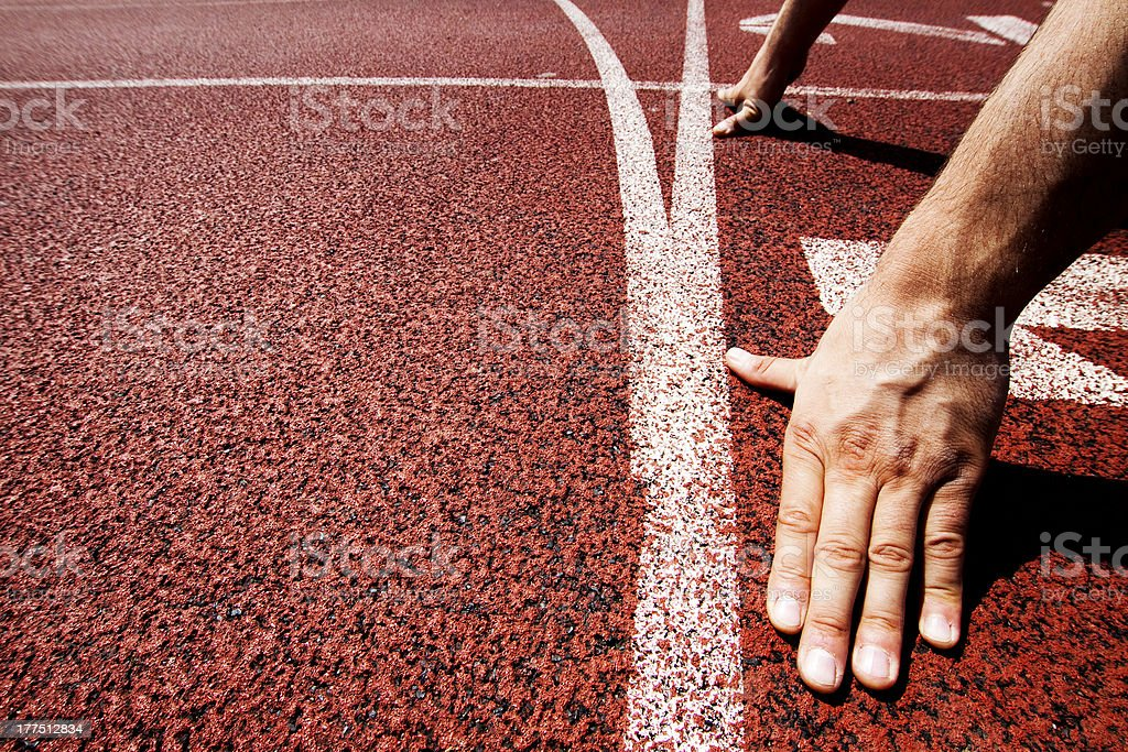 Runner hands on starting line stock photo