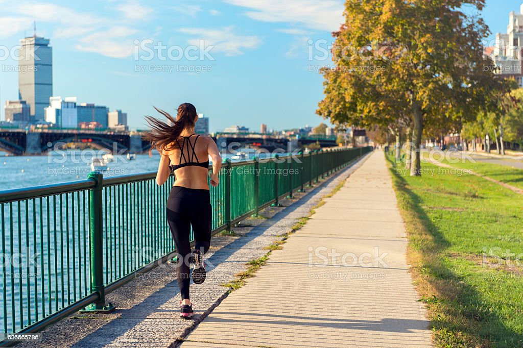 Runner in front of Boston's Skyline stock photo