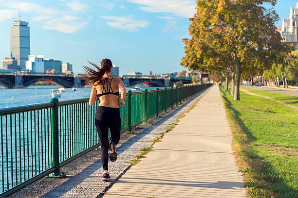 Runner in front of Boston's Skyline stock photo