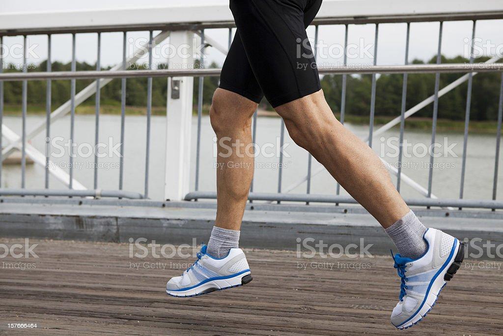 Runner in mid stride stock photo