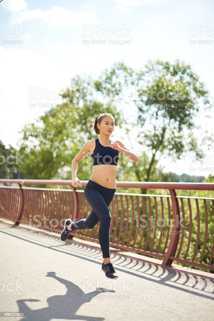 Runner in mid-air stock photo