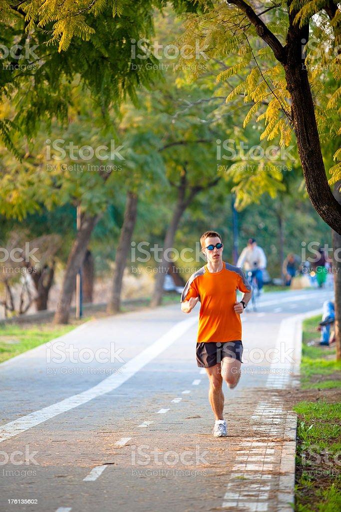 Runner in orange shirt stock photo
