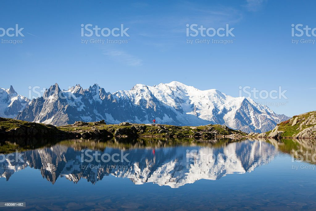 Runner in red runs in the French Alps near Chamonix stock photo