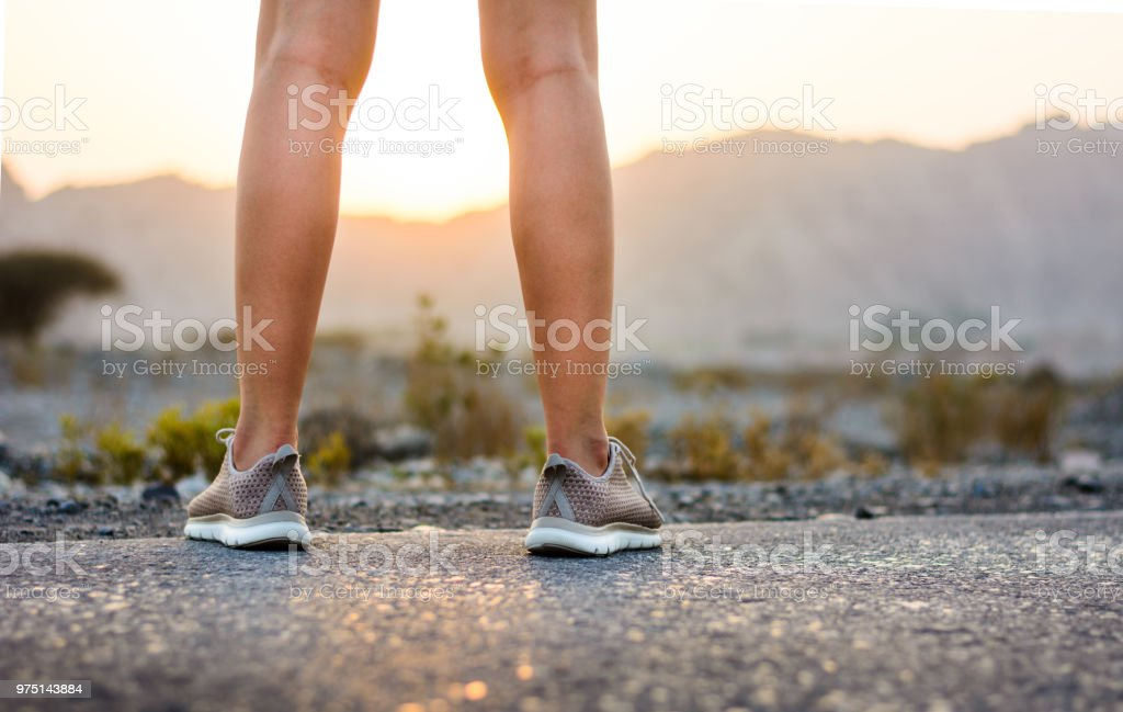 Runner in the desert low angle view stock photo