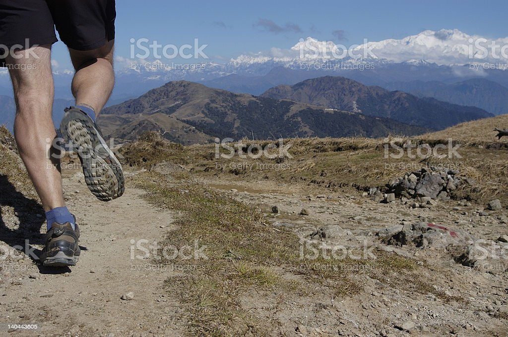 Runner in the Himalayas stock photo