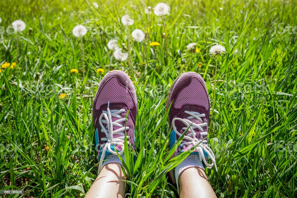 Runner is having a rest on the grass royalty-free stock photo