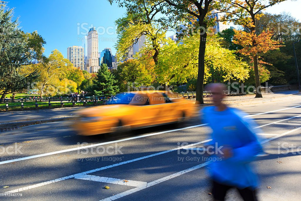 Runner jogging in Central Park, New York City royalty-free stock photo
