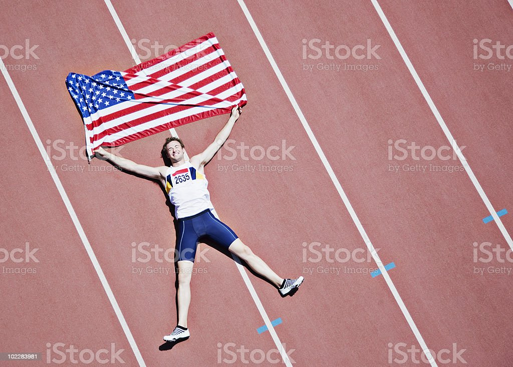 Sentar on track Runner con bandera estadounidense - foto de stock