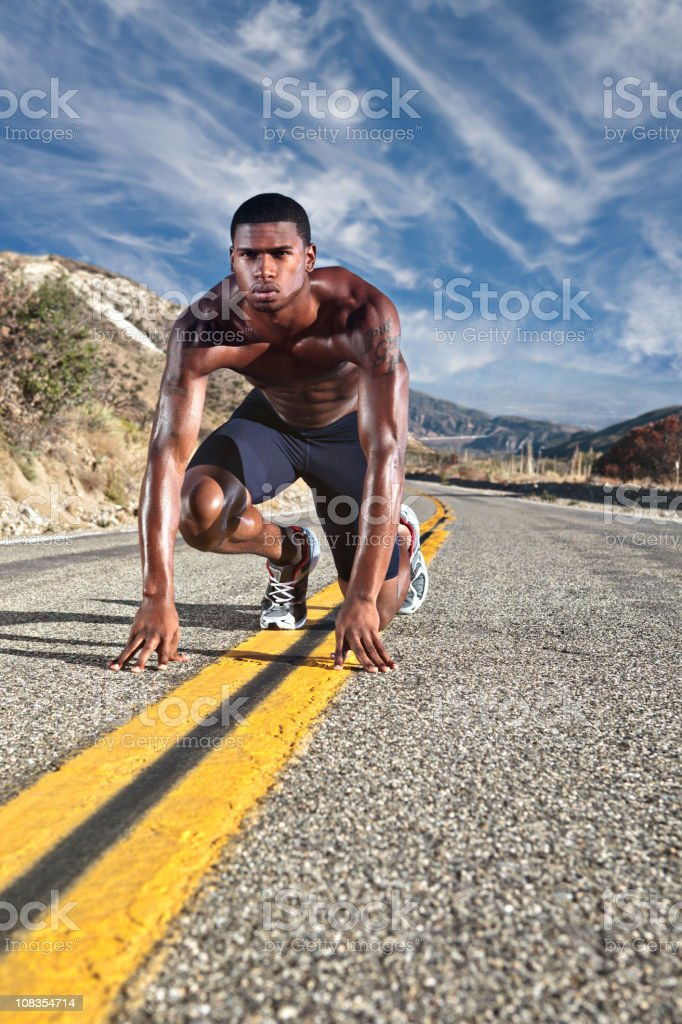 runner lined up on mountain road royalty-free stock photo