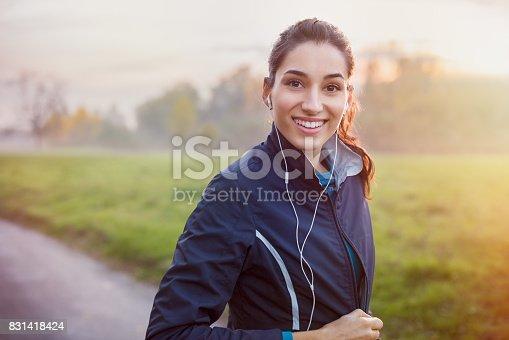 istock Runner listening music 831418424