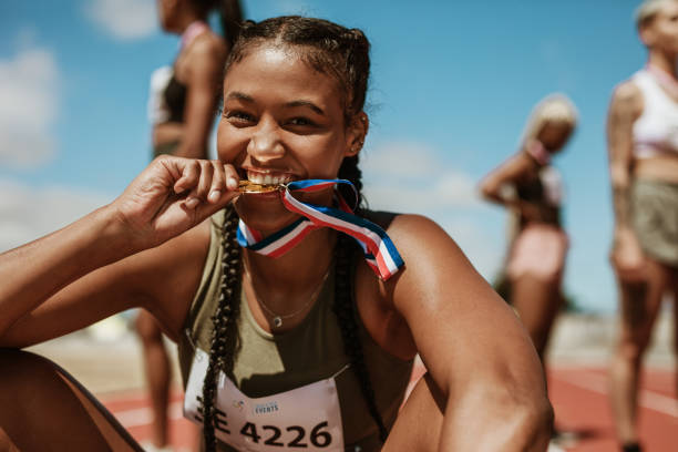 Runner looking excited after winning a medal stock photo