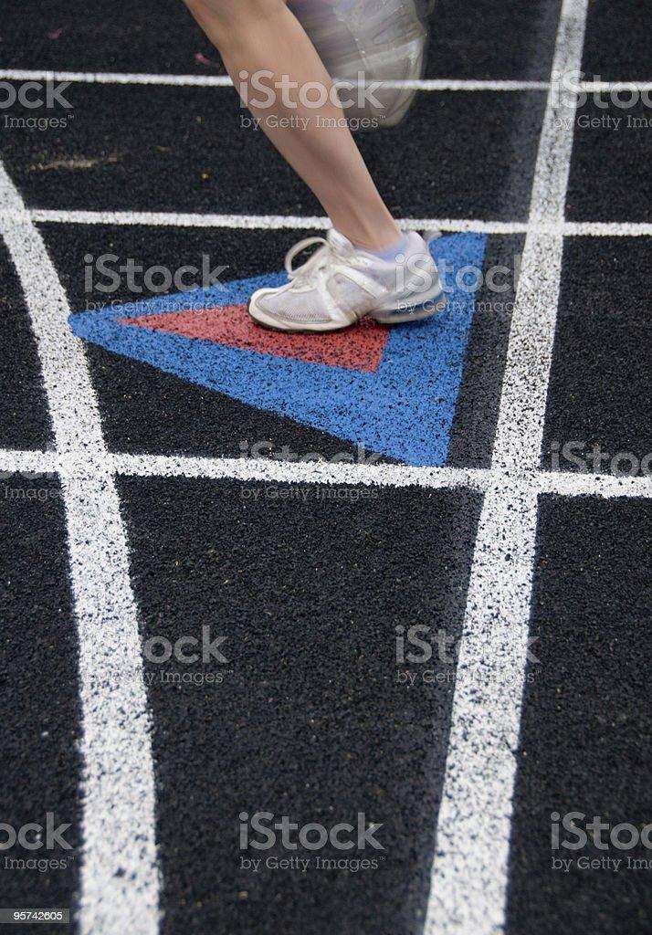 Runner on a black track. stock photo