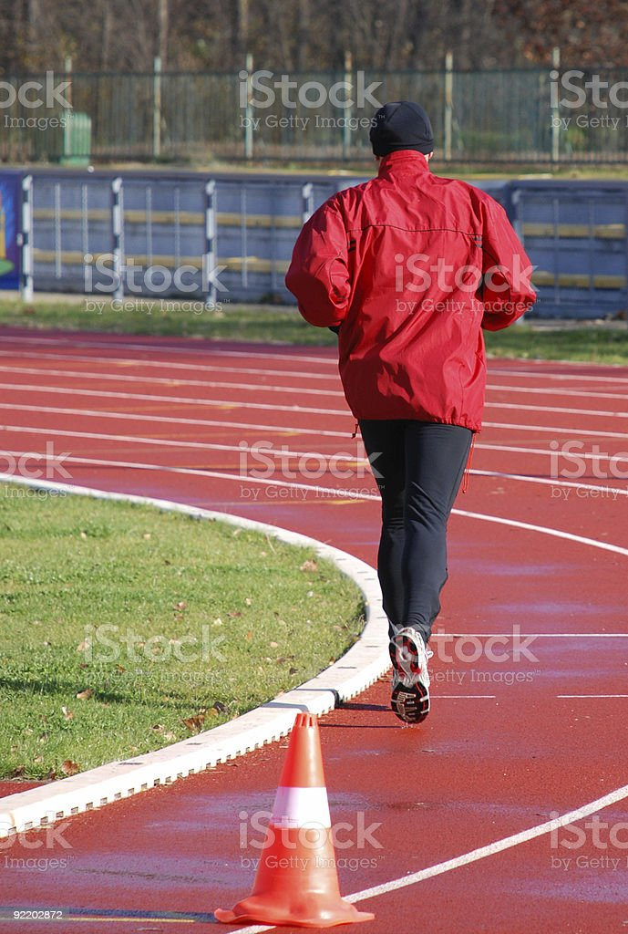runner on the running track royalty-free stock photo