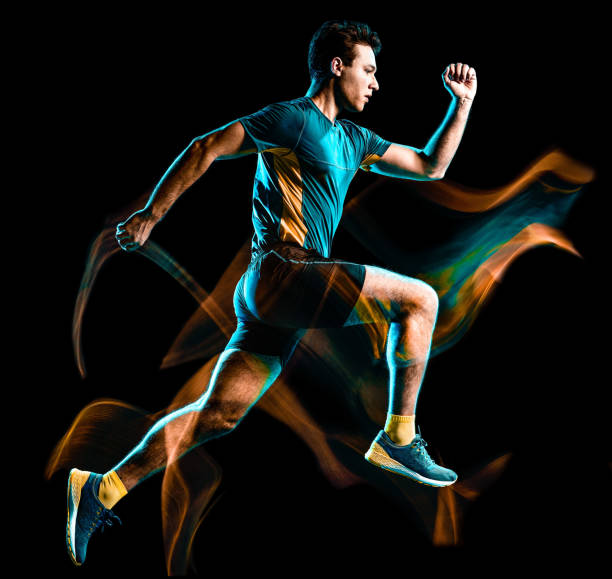 runner running jogger jogging man isolated light painting black background stock photo