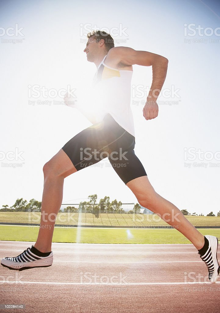 Runner running on track royalty-free stock photo
