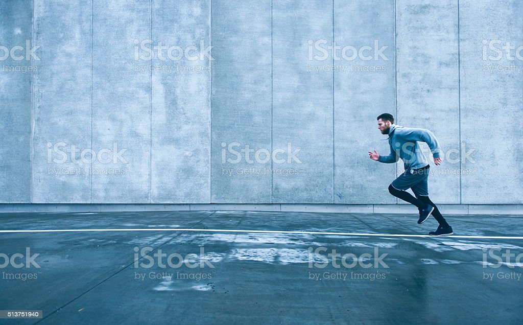 Runner sets of with fast pace and goes for run stock photo