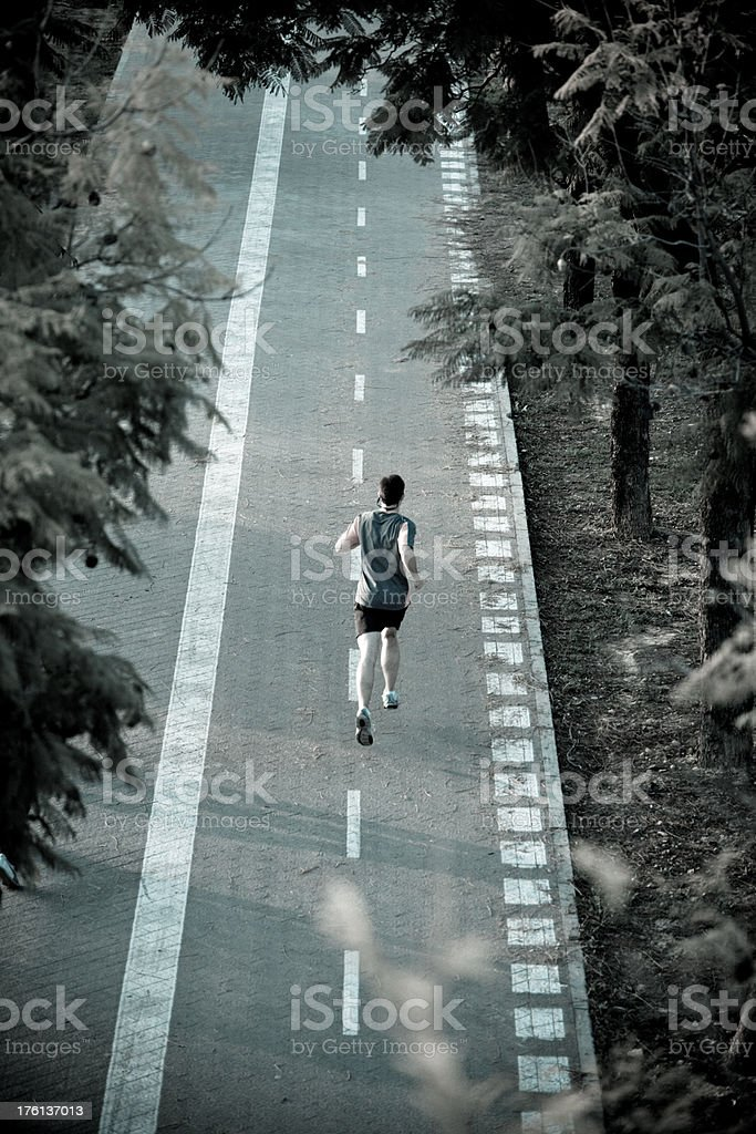 Runner sprinting down a track royalty-free stock photo