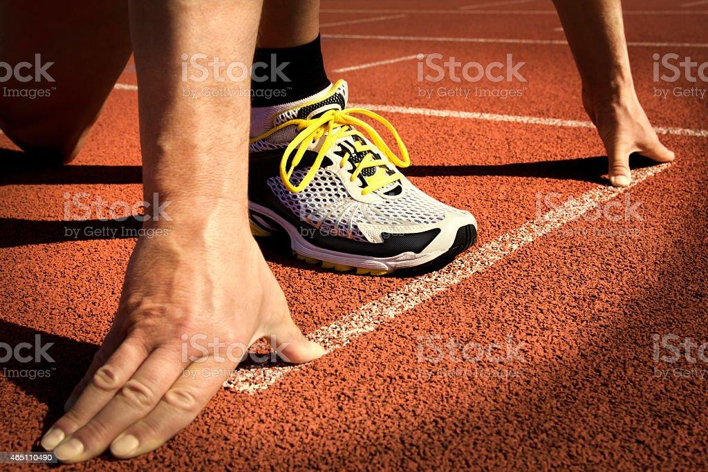 runner stadium start position stock photo