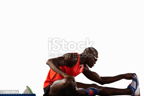 istock Runner stretching at starting line 129943944