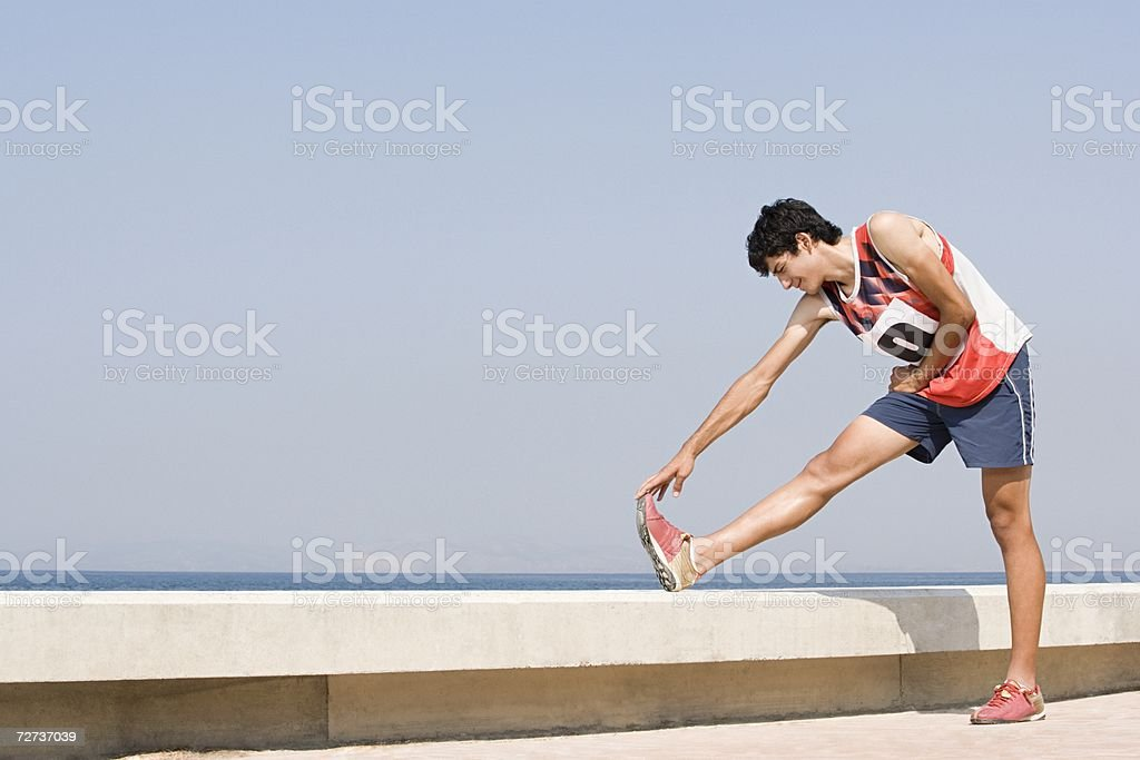 Runner stretching royalty-free stock photo