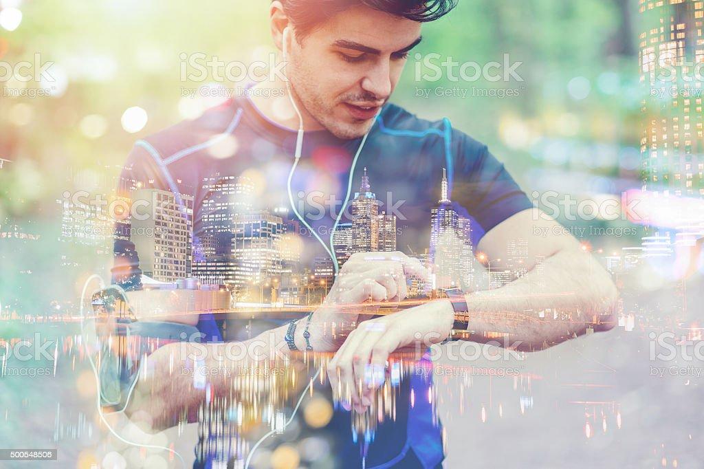 Runner taking pulse on smart watch stock photo