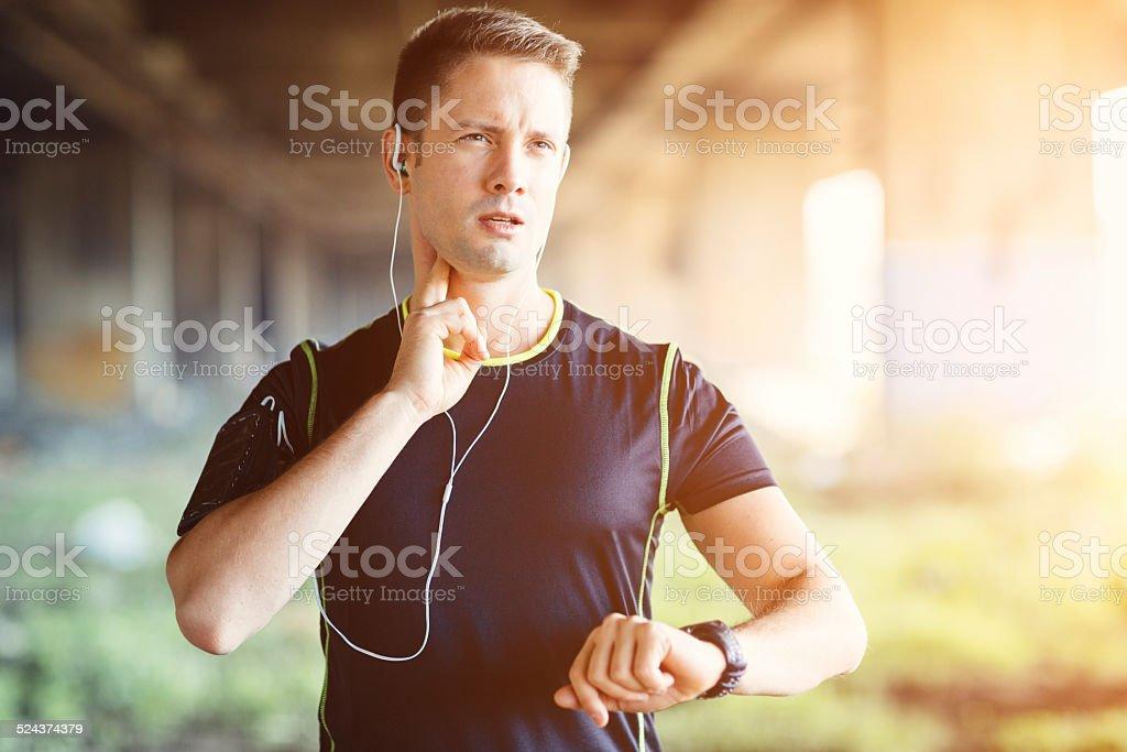 Runner Taking Pulse. stock photo