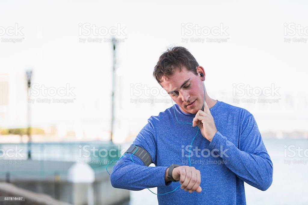 Runner taking pulse stock photo