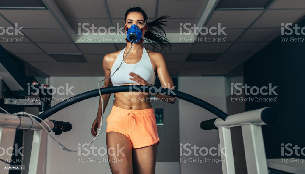 Runner testing her performance in sports science lab stock photo