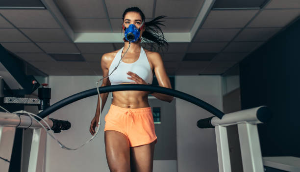 runner testing her performance in sports science lab - carpet runner stock photos and pictures