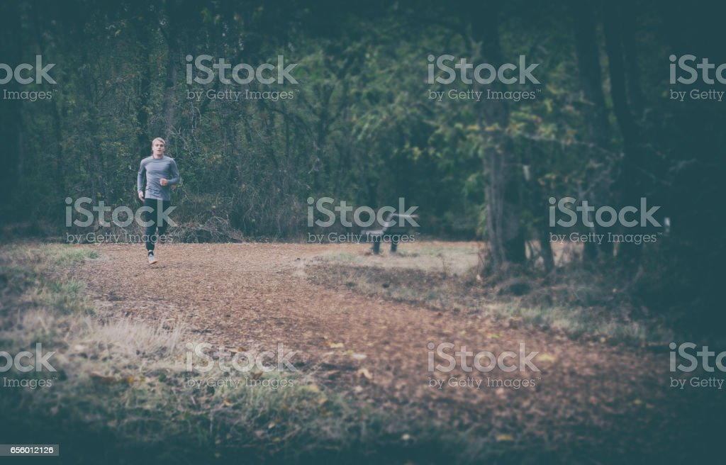 Runner Training on Dark Moody Day stock photo