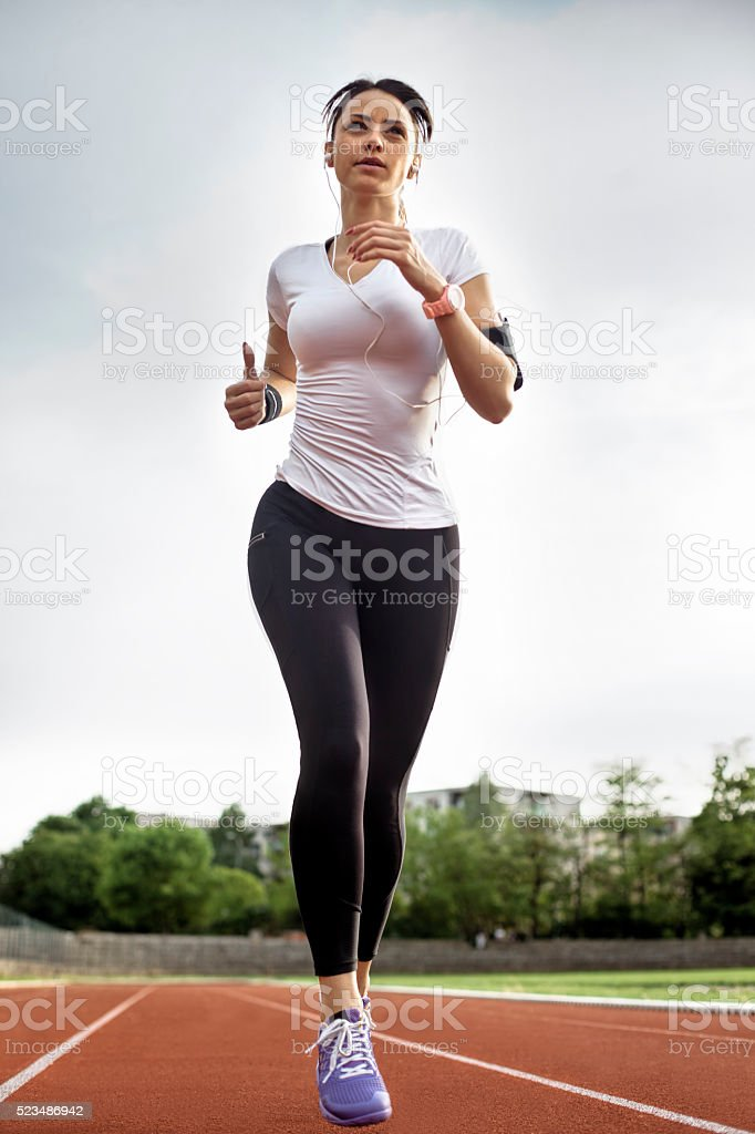 Runner trainning at a racetrack stock photo