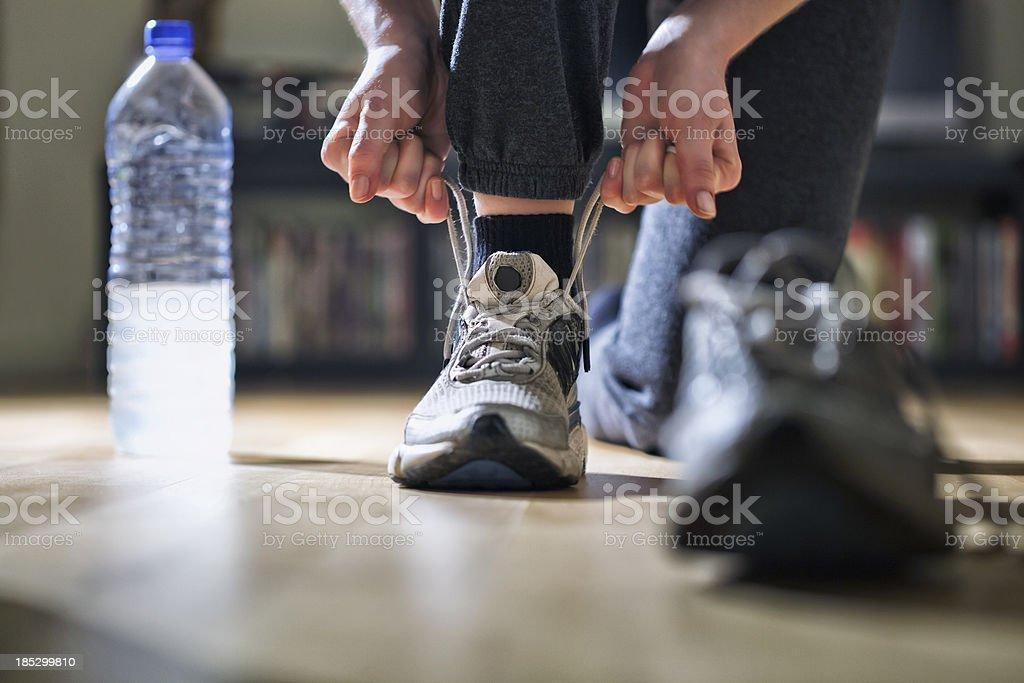 Runner Tying Her Shoes stock photo